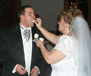 The Bride feeds the Groom
