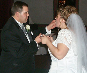 The Groom feeds the Bride.