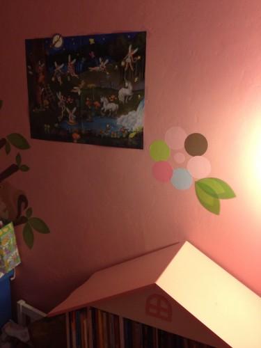 Eva's new Glow-In-The-Dark Glowing Fairies Poster Poster hanging in her room.