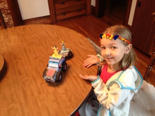 Eva using the ATV to haul princesses around