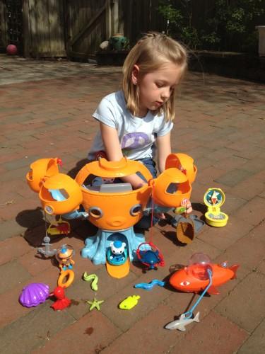 Eva playing with her Octonauts