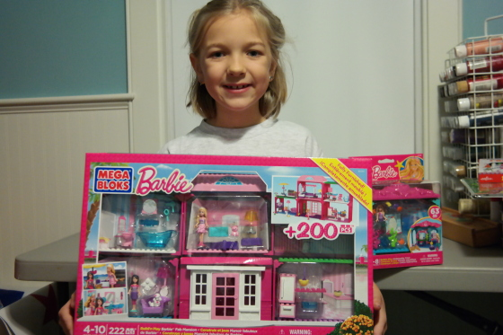 Eva holding the MEGA Bloks Barbie Fab Mansion