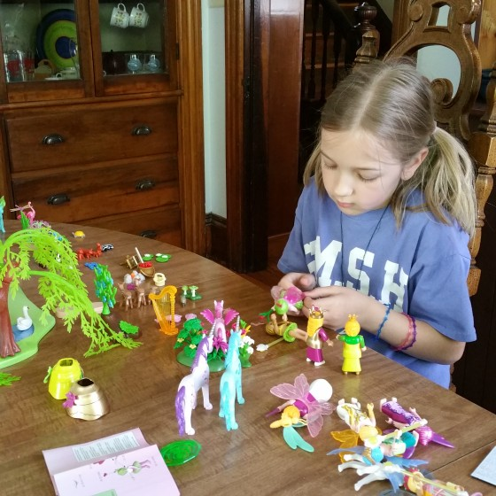 Eva playing with her Playmobil Character.