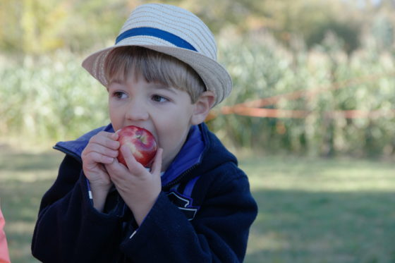 Andrew in a Fedora with an Apple